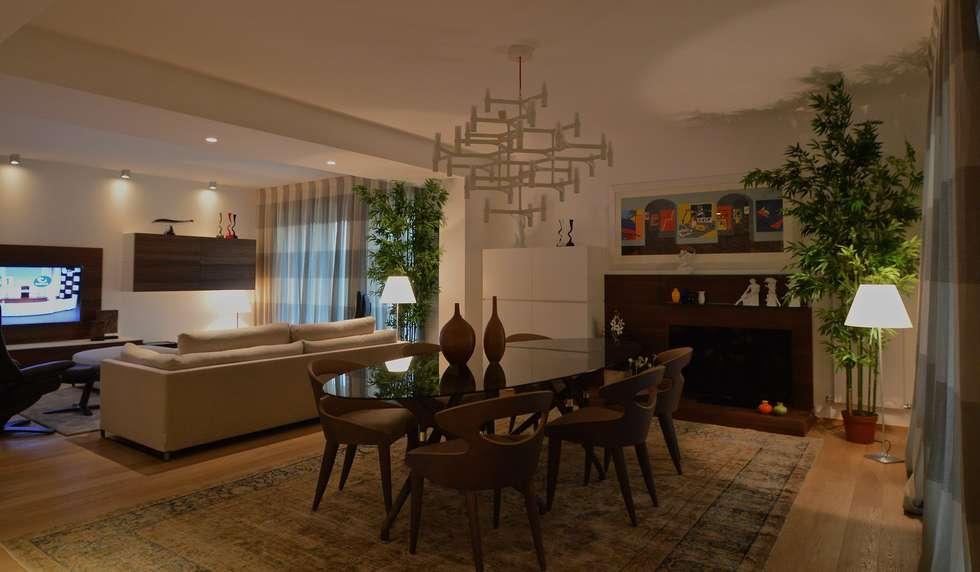 Appartamento M: Sala da pranzo in stile in stile Moderno di Signum Contract
