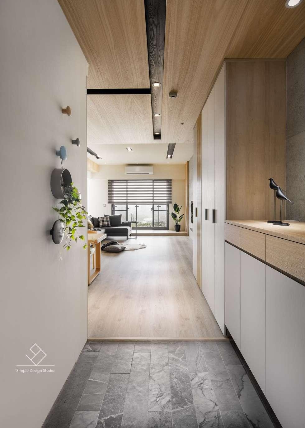玄關設計:  走廊 & 玄關 by 極簡室內設計