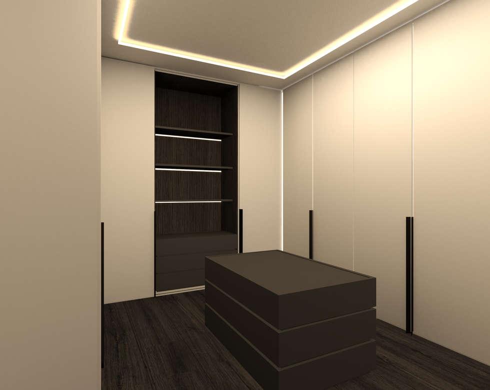 cabina armadio: Camera da letto in stile in stile Moderno di Giemmecontract srl.