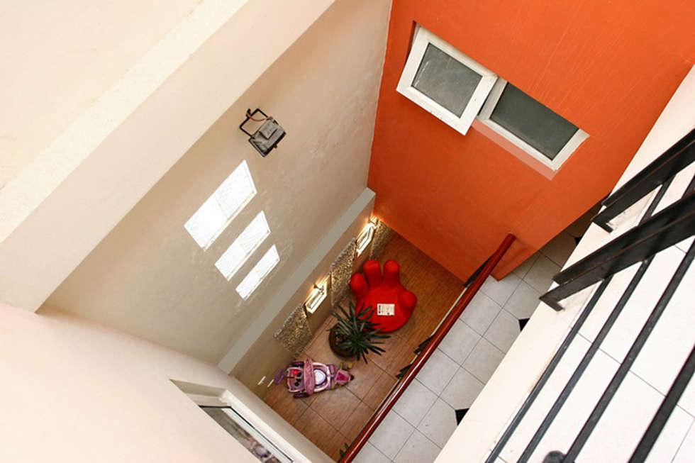 Không gian tầng 2 và 3: phòng ngủ và sân thượng:  Giếng trời by Công ty TNHH Xây Dựng TM – DV Song Phát