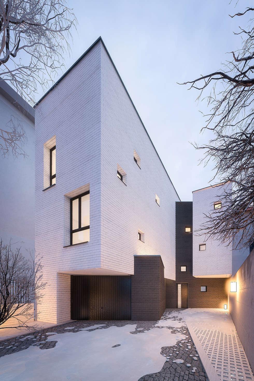 Maison contemporaine Enghien Les Bains: Maison individuelle de style  par Fabrice Commercon