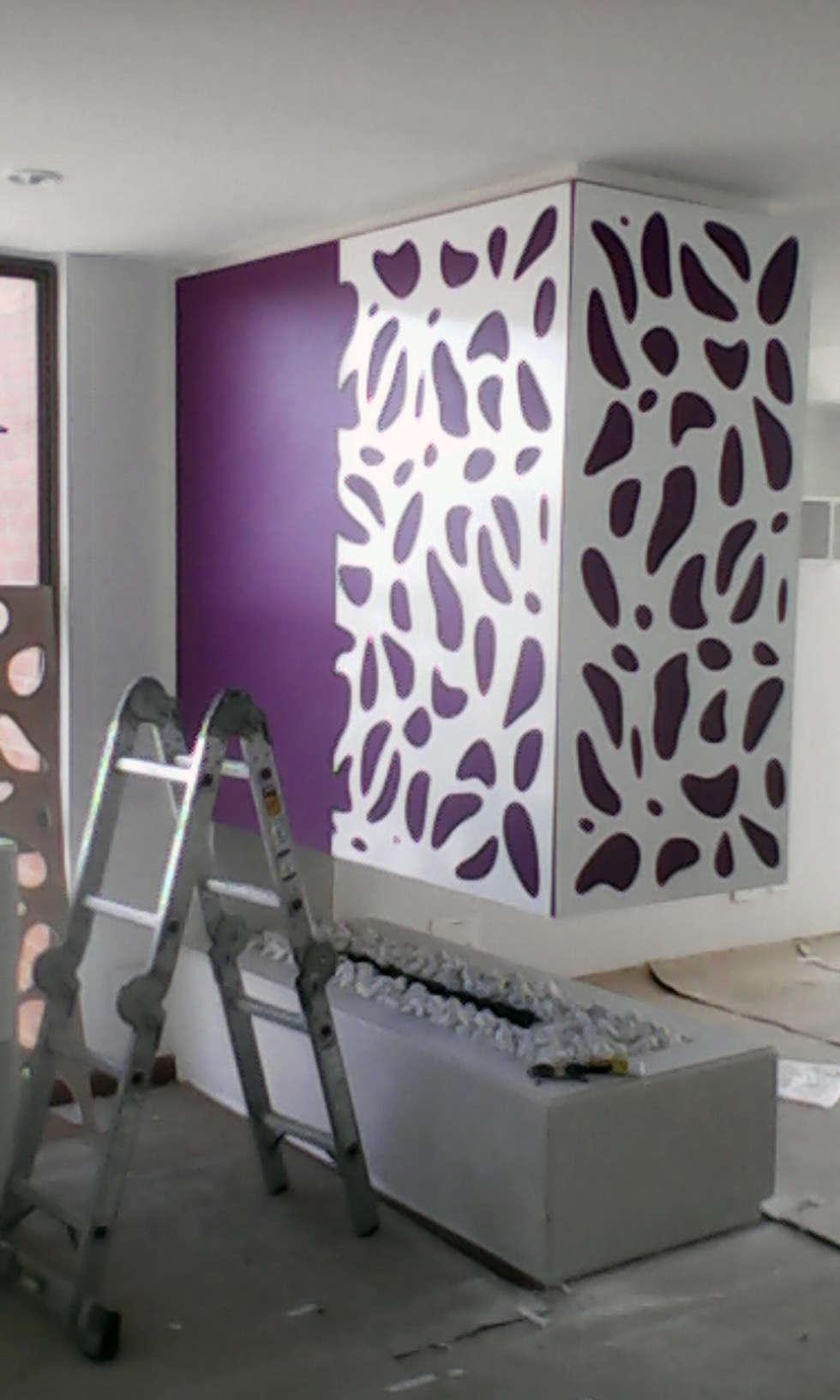 piel para chimenea 2: Salas de estilo moderno por Omar Plazas Empresa de  Diseño Interior, remodelacion, Cocinas integrales, Decoración