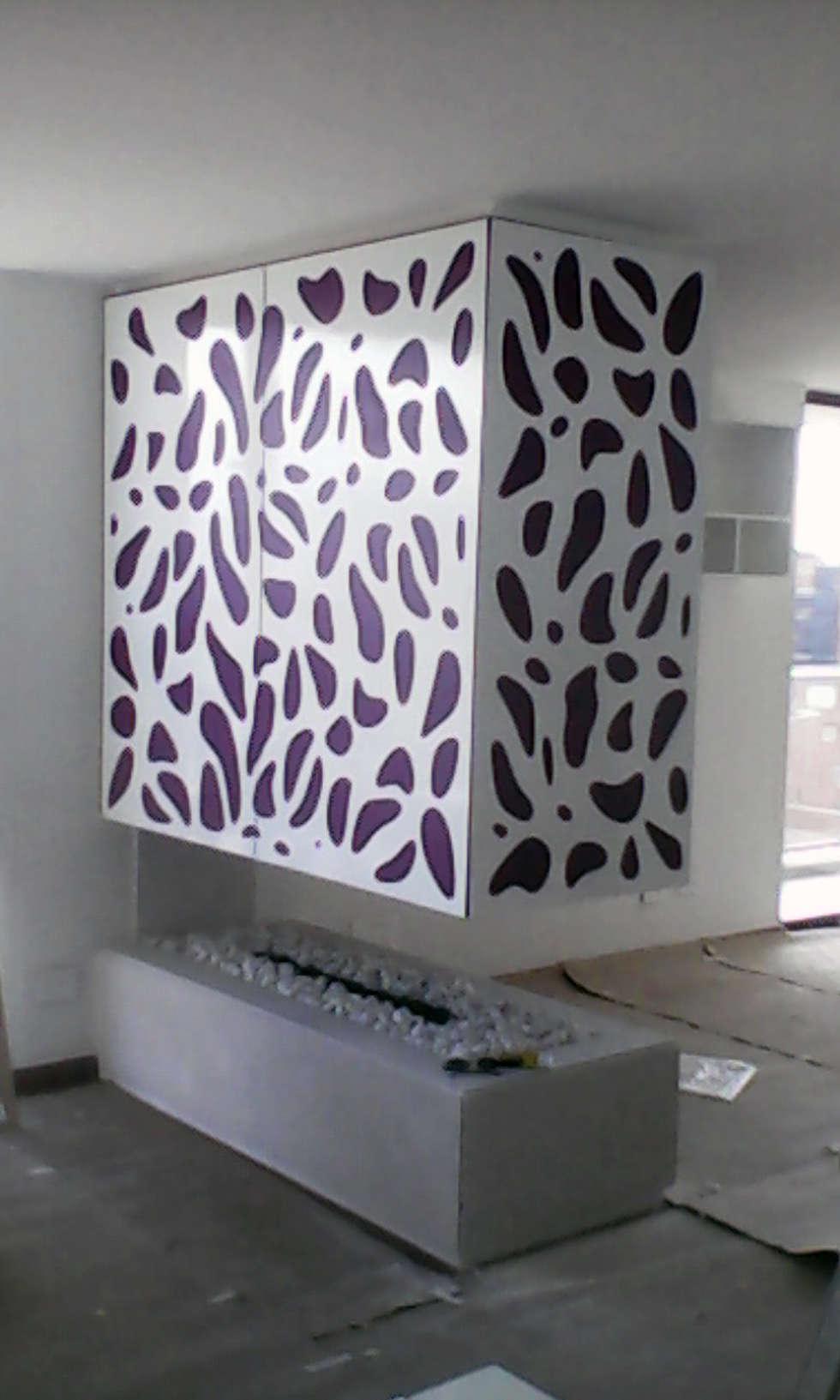 piel para chimenea 3: Salas de estilo moderno por Omar Plazas Empresa de  Diseño Interior, remodelacion, Cocinas integrales, Decoración