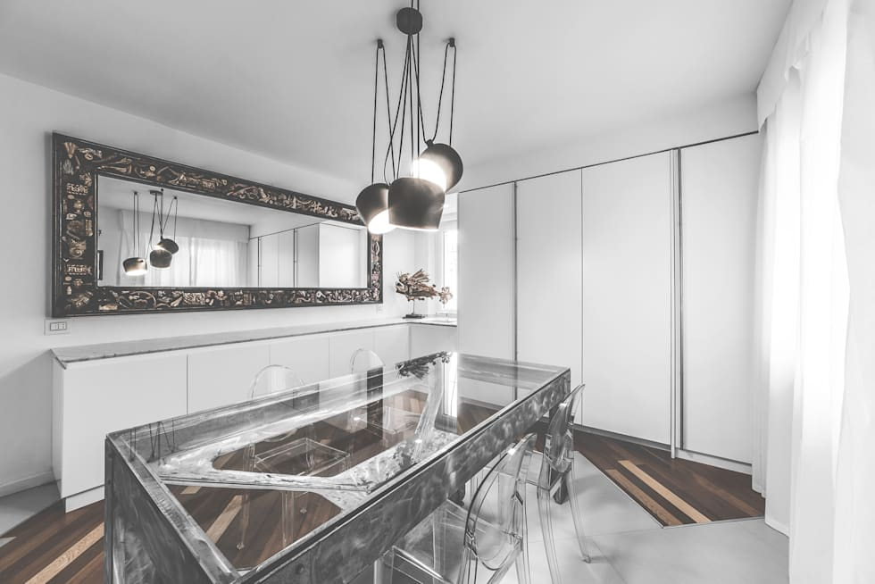 Cucina a scomparsa totale: Cucina in stile in stile Eclettico di MODO Architettura