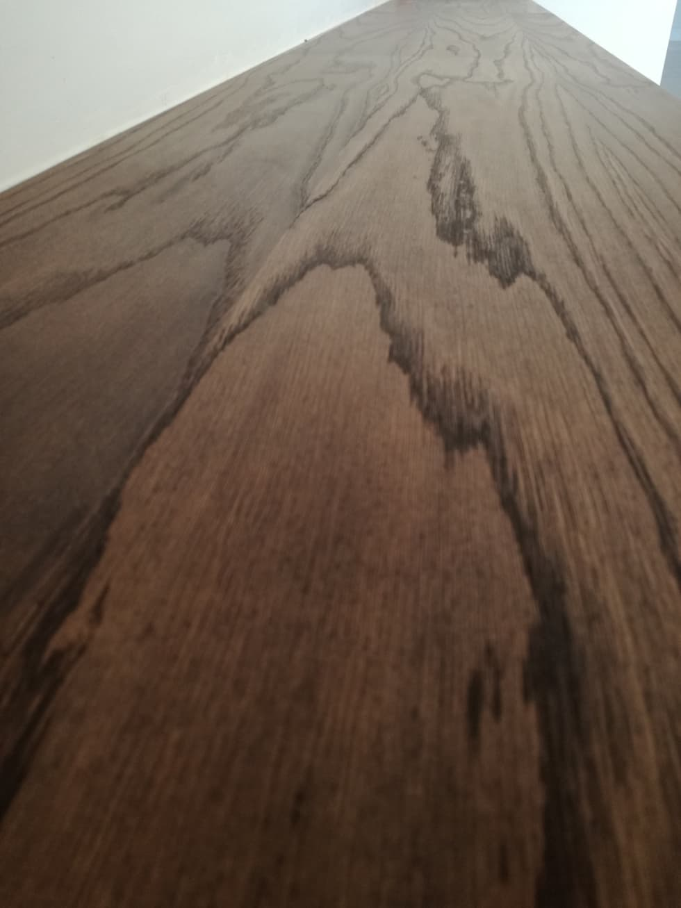 white oak with dark smoke oil paint:  Built-in kitchens by Première Interior Designs