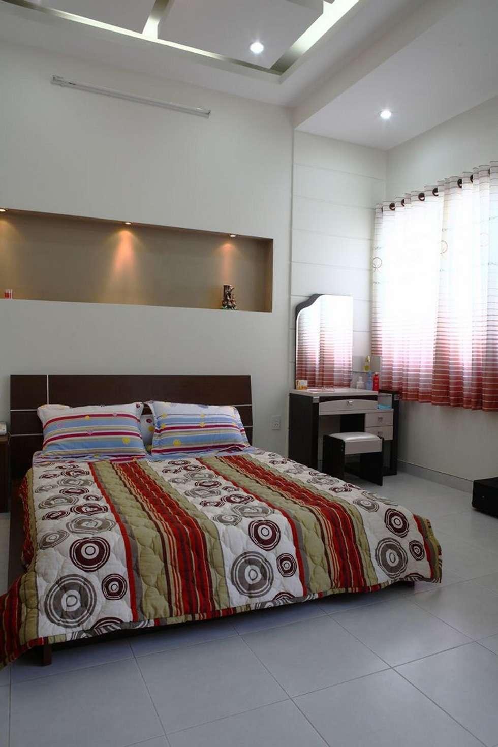 Phòng ngủ đơn giản, tiện nghi:  Phòng ngủ by Công ty TNHH Xây Dựng TM – DV Song Phát