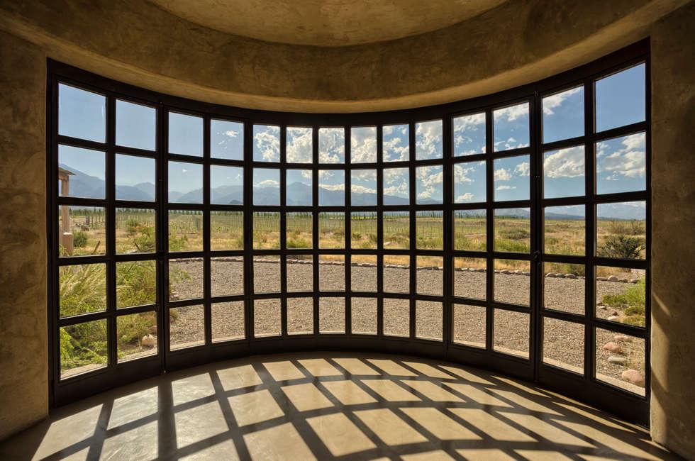 Alpasion   Interiores: Hoteles de estilo  por Bórmida & Yanzón arquitectos
