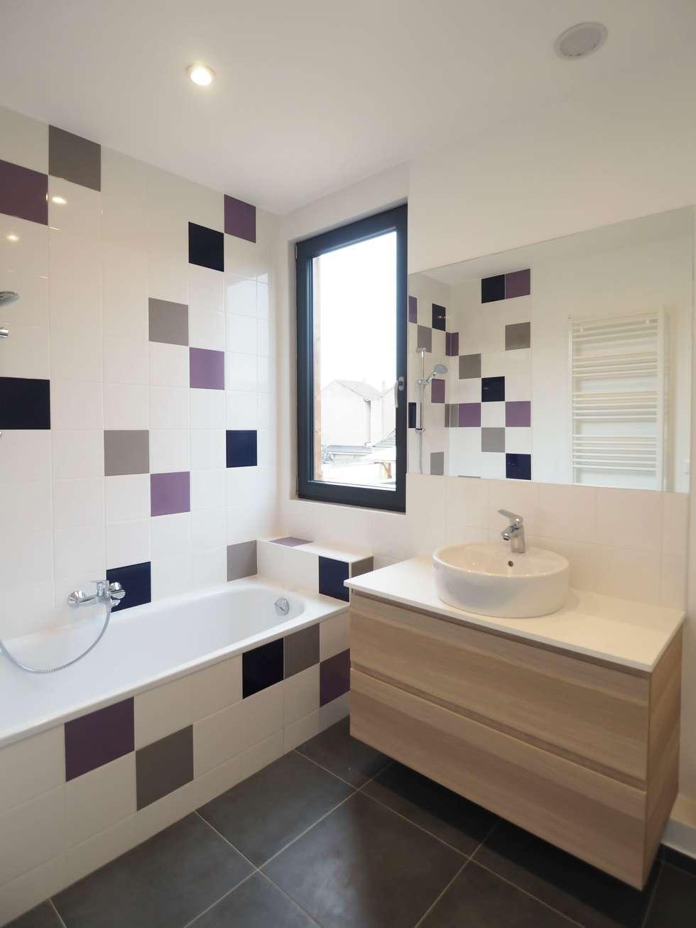 2 maisons contemporaines à Epinay sur Seine: Salle de bains de style  par Fabrice Commercon