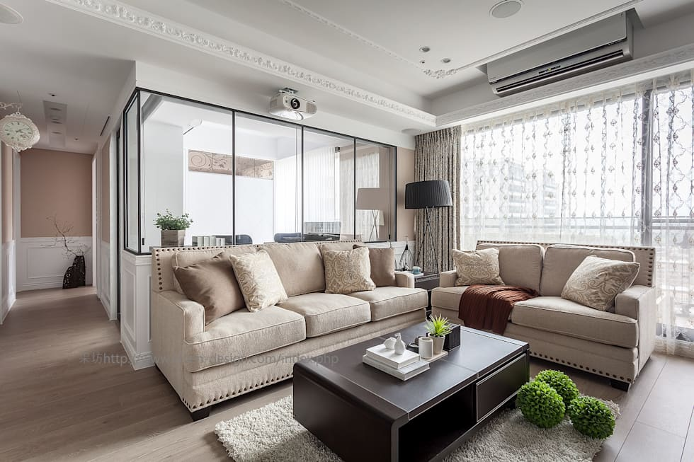 和樂:  客廳 by 采坊設計