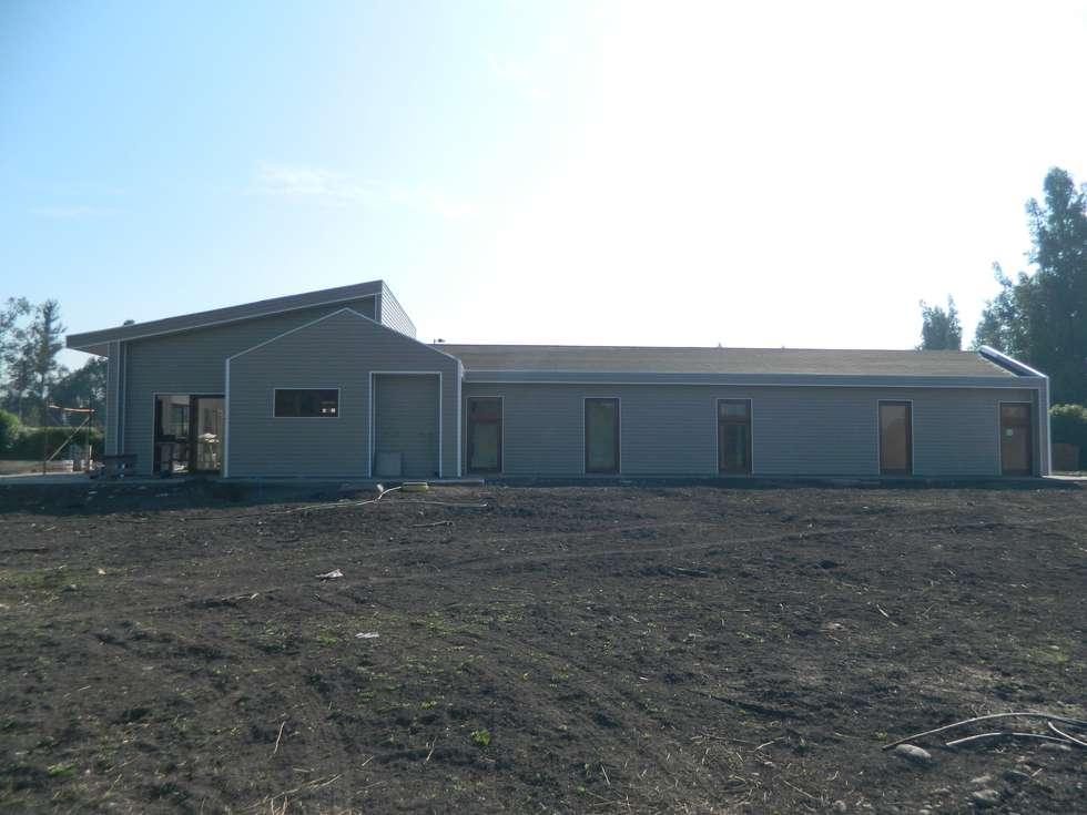 Casa siding Isla de Maipo: Casas de estilo mediterraneo por AG Gestión