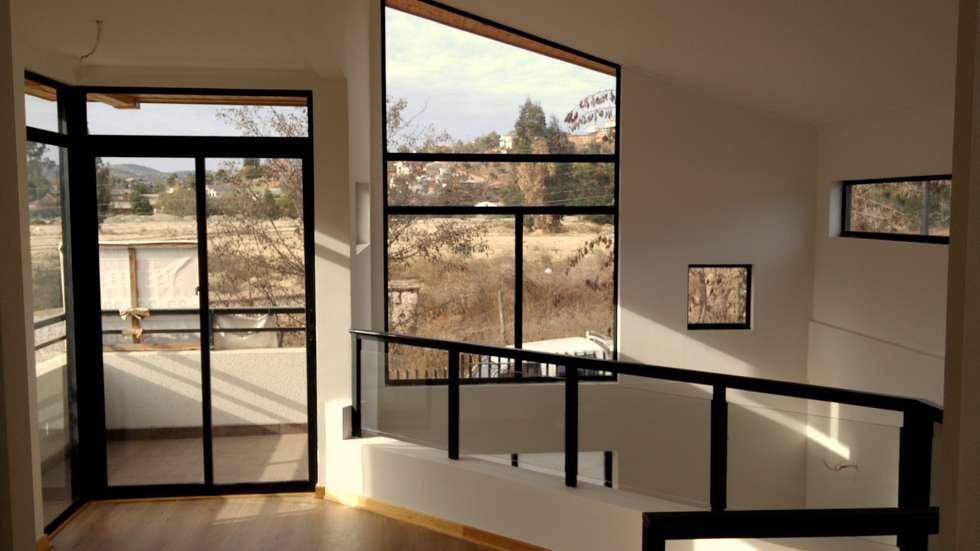 Casa Gral.Cruz: Livings de estilo moderno por Lau Arquitectos
