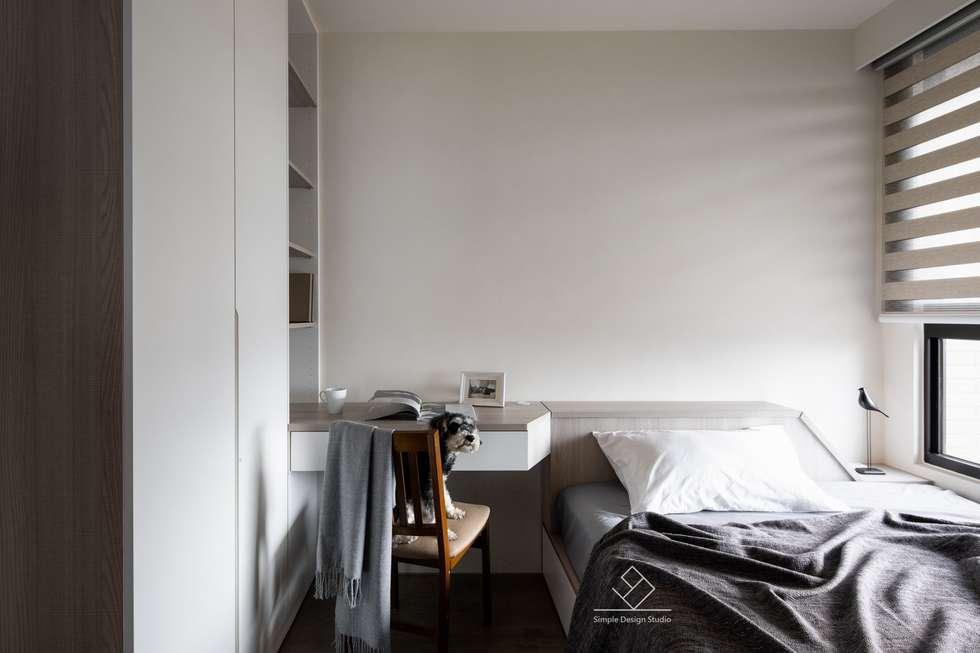 客房:  臥室 by 極簡室內設計
