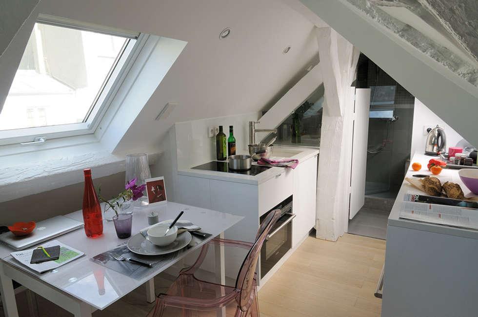 Rue des Canettes: Salle à manger de style de style Moderne par Atelier Sylvie Cahen