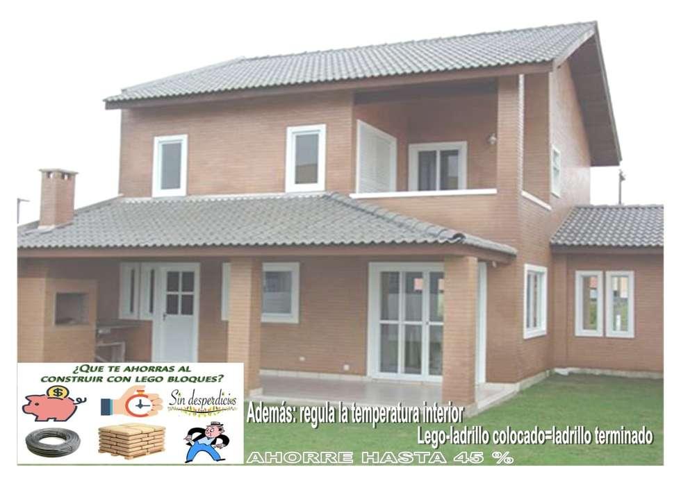 LA BELLEZA ESTETICA + AHORRO + SOLIDEZ  DE LA  CASA DE LEGO-LADRILLOS DE OBRA  LIMPIA: Casas prefabricadas de estilo  por MIKASALISTA CA