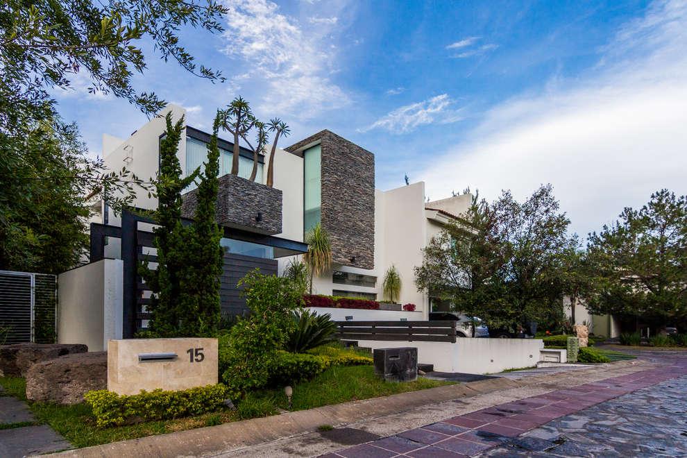 Casas de estilo moderno por aaestudio