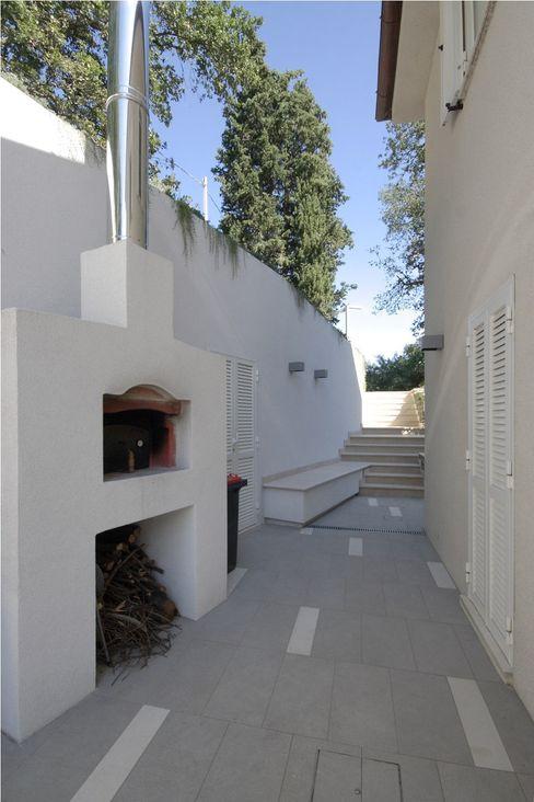 laboratorio di architettura - gianfranco mangiarotti Garden Fire pits & barbecues