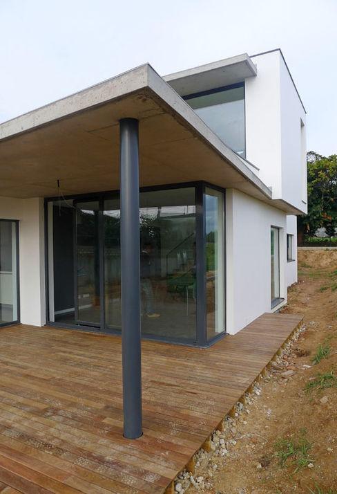 Vivienda en Rúa Aba AD+ arquitectura Casas unifamilares Blanco