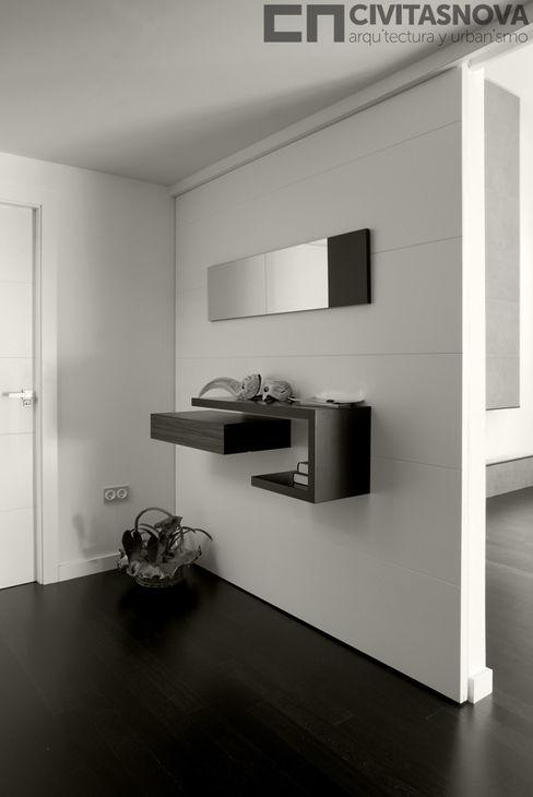 CIVITASNOVA - Vestíbulo: tabique corredero con mueble auxiliar CIVITASNOVA Pasillos, vestíbulos y escaleras de estilo moderno