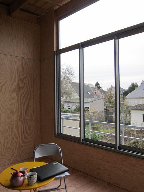 Vue depuis le jardin d'hiver Cécile GAUDOIN Architecte DPLG Jardin d'hiver rural