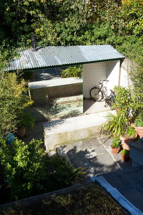 homify Modern garage/shed