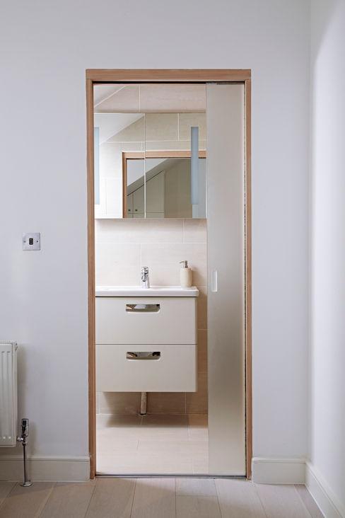 En Suite with Pocket Door Collective Works Modern Bathroom
