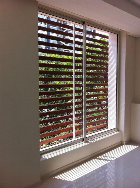 Ventanas Corredizas homify Puertas y ventanas de estilo clásico Aluminio/Cinc Blanco