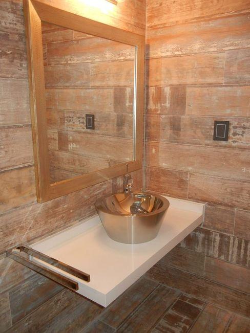 Casa en San Isidro reforma interior Fainzilber Arqts. Baños modernos