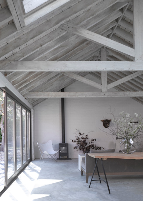 The living room at the Cow Shed Nash Baker Architects Ltd Modern Living Room Wood Grey