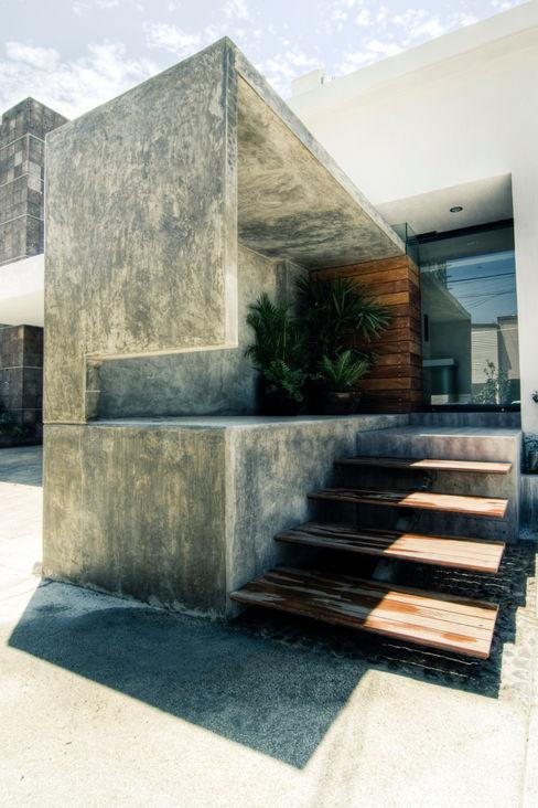 TAQ arquitectura Casas de estilo minimalista Hormigón Gris
