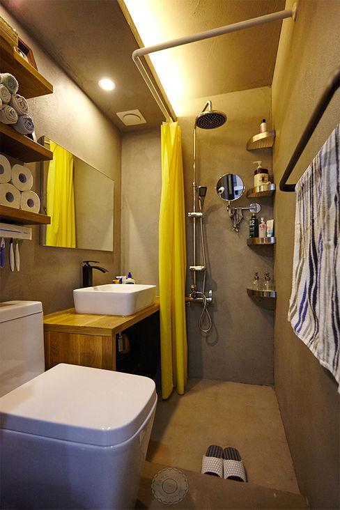 homify Industrial style bathroom Concrete Grey