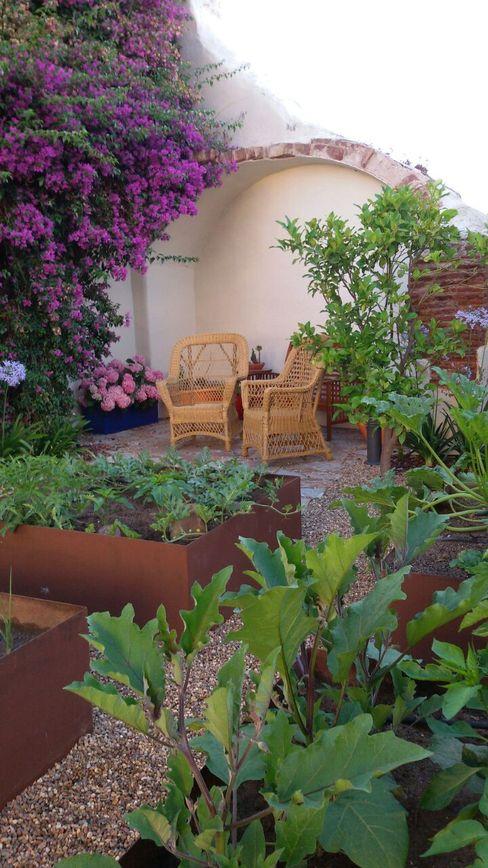 Huerto en el jardín homify Jardines de estilo ecléctico