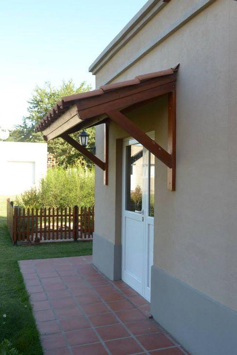 GD Arquitectura, Diseño y Construccion Classic style houses