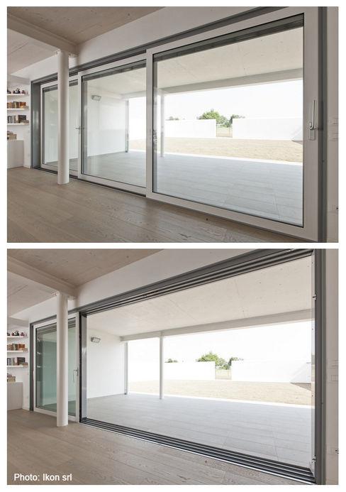 La continuità tra interno ed esterno Margherita Mattiussi architetto Finestre & PorteFinestre Alluminio / Zinco Bianco