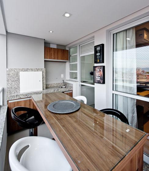 Sacada (espaço gourmet) homify Varandas, alpendres e terraços industriais