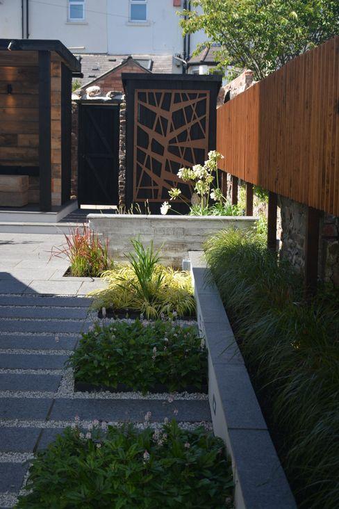 Black granite and concrete shutter board wall Robert Hughes Garden Design Industrial style garden