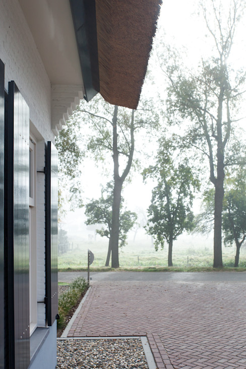 Voorzijde landelijke woning, Ewijk homify Landelijke huizen