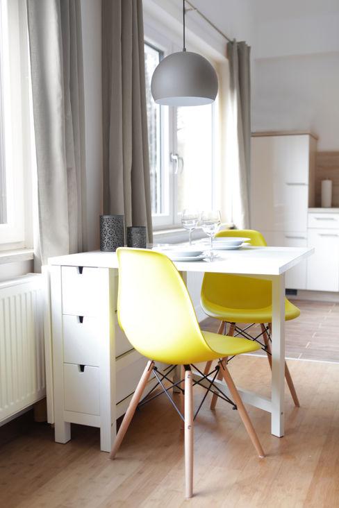 Studio Dooie Ruang Makan Modern Yellow