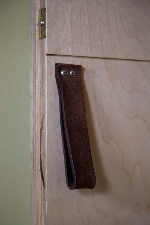 Leather door handle in custom birch ply door Research + Design