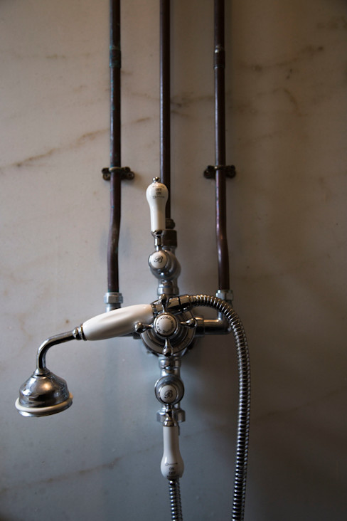Shower mounted on recalimed Colorado Gold marble slab Research + Design