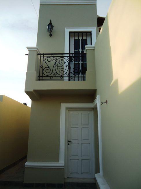 Vivienda Unifamiliar Valy Casas de estilo clásico Ladrillos Verde