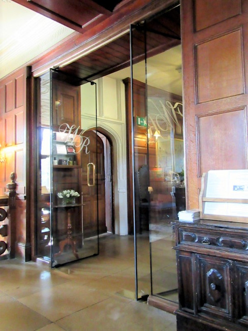 Frameless glass fire doors at Heritage hotel Ion Glass Glass doors