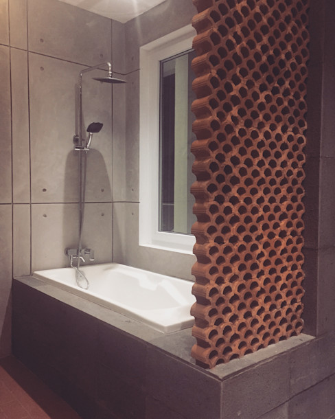 Hanez ミニマルスタイルの お風呂・バスルーム コンクリート 灰色