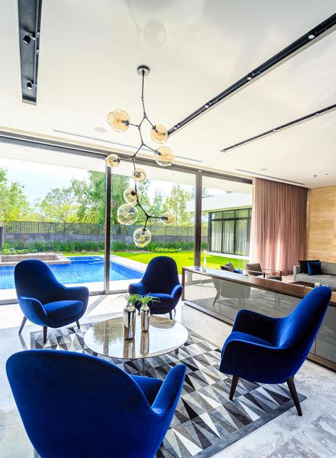 LIVING ROOM - CASA YÉJ TRES MAS DOS ARQUITECTOS Salones modernos Mármol Azul