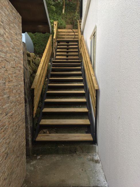 homify Rustic style corridor, hallway & stairs Wood Brown