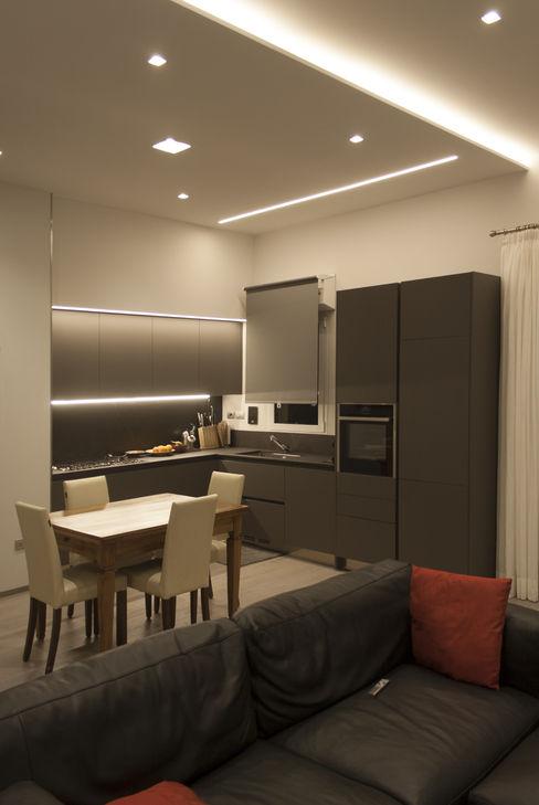Appartamento F+P Architettura & Interior Design 'Officina Archetipo' Sala da pranzo moderna