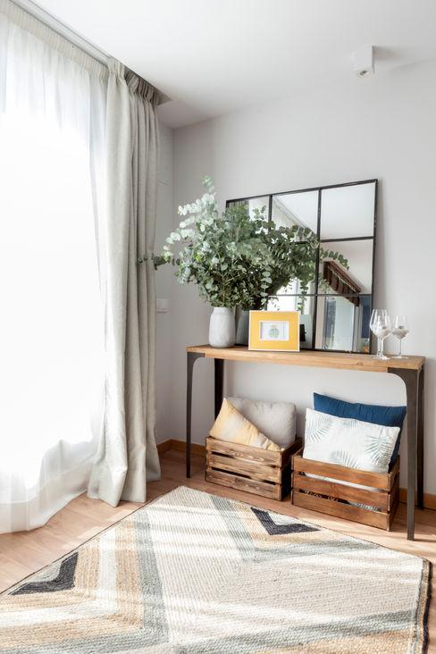 Reforma y Amueblamiento en sótano de vivienda unifamiliar adosada en Tres Cantos itta estudio Salones de estilo industrial