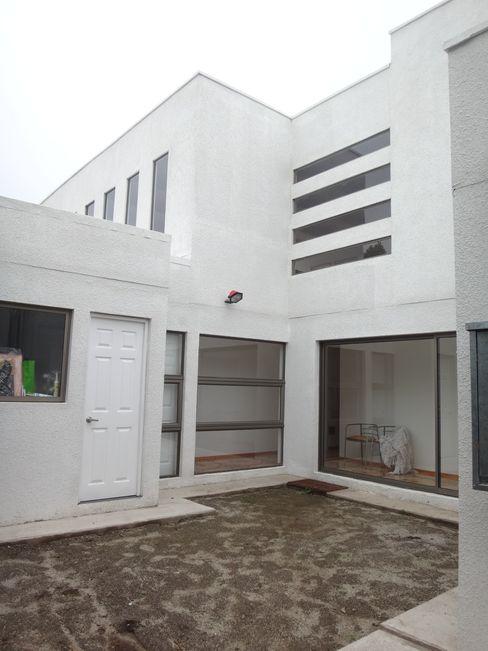 FACHADA SUR ARKITEKTURA Casas unifamiliares Ladrillos Blanco