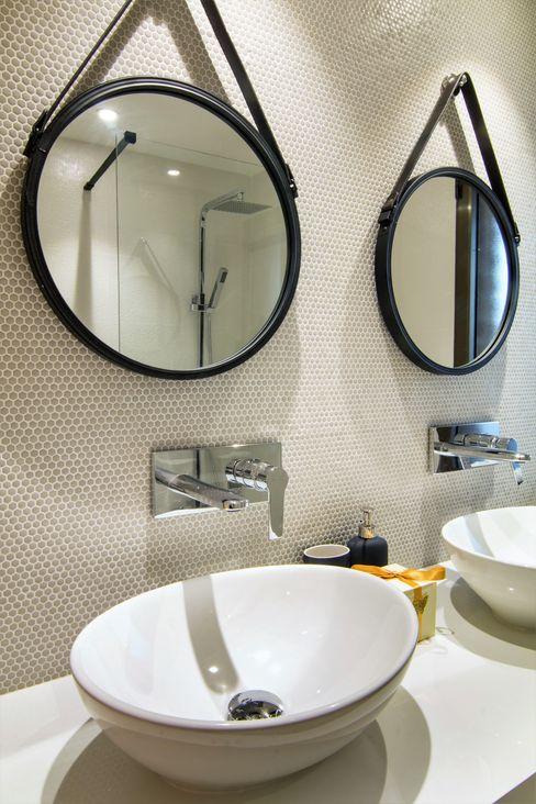 Detalle del baño del dormitorio ppal. homify Baños de estilo ecléctico Mármol Beige