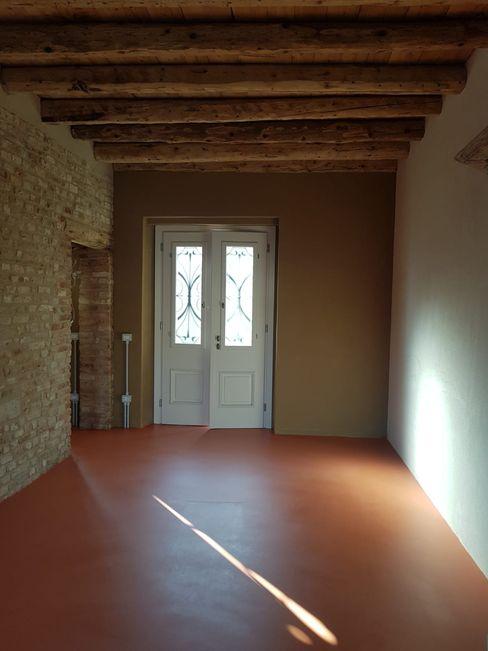 Pavimento in resina in un casale COVERMAX RESINE Pavimento Arancio