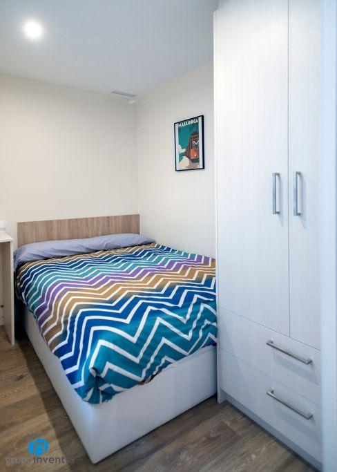 Dormitorios amueblados Grupo Inventia Dormitorios de estilo moderno Hormigón Beige